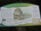 An informative sign talks about Lewis and Clark's journal describing their sighting of Beacon Rock.