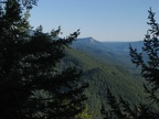 There are some views to the east through the Douglas fir trees on the south end of the summit of Bunker Hill.