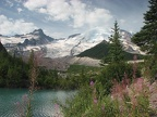A turquoise lake provides a nice contrast to Mt. Rainier close to the Emmons Glacier View Trail.