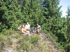 Chris, Janel, Joe, and Ryan taking a lunch break on a knoll along the Glacier View Trail.