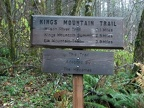 Mileage sign near the trailhead of King's Mountain Trail in the Tillamook State Forest, Oregon.