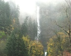 Multnomah Falls cascades hundreds of feet down a sheer cliff into a plunge pool, then over another waterfall.