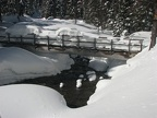The log bridge over Clark Creek is so full of snow that it isn't useable until some of the snow melts. There are usually snow bridges just upstream from the bridge that are used.