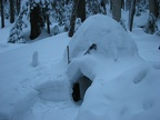 Completed igloo covered with new snow.