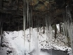 Icicles grow from the overhang behind Ponytail Falls