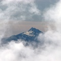Mt. Jefferson appears as a phantom in the mist from Timberline Lodge.