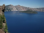 Wizard Island rises above the azure blue water of Crater Lake.
