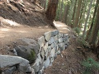 Hundreds of volunteers donated thousands of hours of work to rebuild this trail. Here is an example of a rock wall along the Glacier Basin Trail.