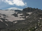 The summit of Mt. Rainier peeks out from the slopes of Glacier Basin.