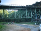 The Thurston Street Bridge crosses over the trail just at the Lower Macleay Trailhead.