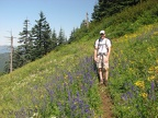 Kevin taking in the sights along  PCT heading to Table Mountain through a field of wildflowers.